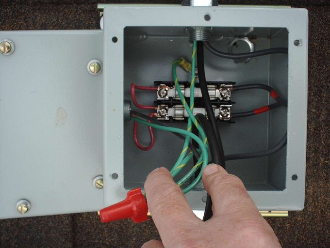 our solar photovoltaid system a view inside the combiner box showing the fuse and fuse holder installation